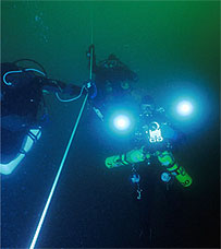 divers on mooring line